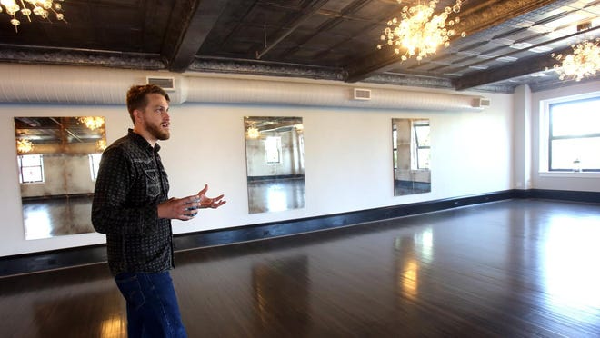 Uptown Indigo director Duncan Blount walks through the banquet hall of the  event space before it was shutdown due to COVID-19 regulations in the state. A recovery grant has made it possible for him to open back up.