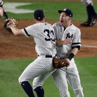 Yankees' Greg Bird, left, and Todd Frazier celebrate