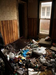 A heavily damaged home filled with garbage and debris at 823 East Jackson St. File photo by Jordan Kartholl.