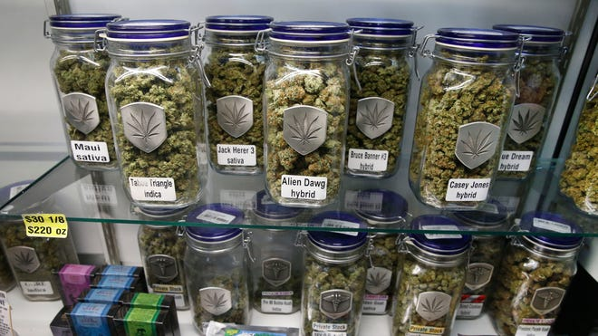 In this Dec. 27, 2013 photo, marijuana and cannabis-infused products are displayed for sale at Medicine Man marijuana dispensary in Denver, which is now open as a recreational retail outlet.