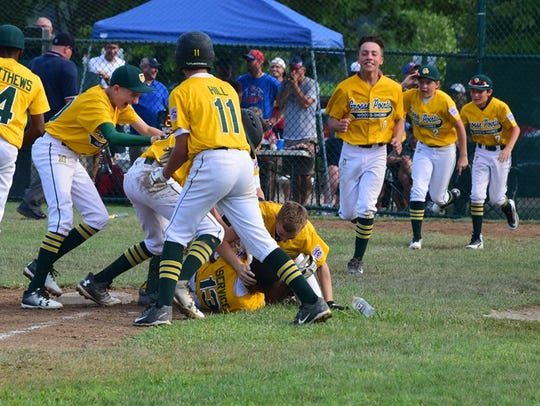 The Grosse Pointe Woods-Shores Little League team celebrates