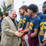 Maryland governor Larry Hogan meets with members of the state championship winning Pocomoke boys basketball team in downtown Pocomoke City on Friday, April 22.