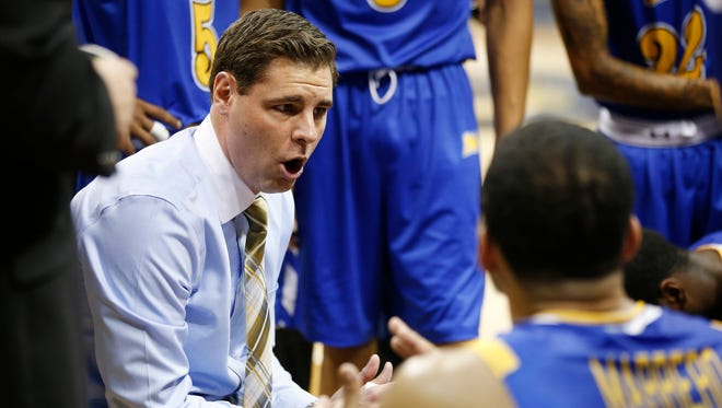 Morehead State coach Preston Spradlin talks to his team in the huddle during a game against Pittsburgh on Nov. 25.