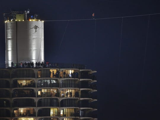 The shadow of daredevil Nik Wallenda is cast against