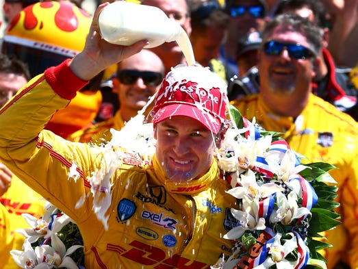IndyCar Series driver Ryan Hunter-Reay dumps milk on his head as he celebrates after winning the 2014 Indianapolis 500 at Indianapolis Motor Speedway.