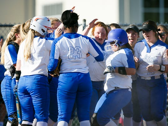 McNary softball congratulates Nicole Duran as she comes in for a home run against Grant High School in the first round of the OSAA 6A state playoffs on Monday, May 22, 2017, at McNary High School in Keizer, Ore. McNary defeated Grant 18-14.