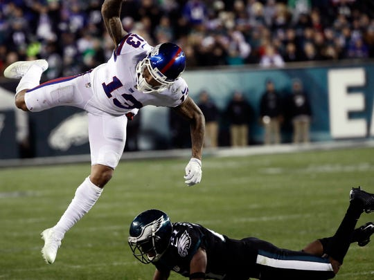 Odell Beckham Jr. is sent flying after a hit by the