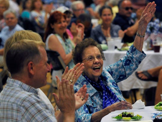 Nell Bright, one of the WASP pilots that trained at Sweetwater's Avenger Field in World War II, waves Saturday as her name is called during a luncheon at Texas State Technical College Sweetwater. Five former Women's Airforce Service Pilots attended the homecoming at the National WASP WWII Museum