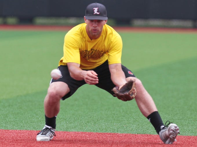 Louisville's Zach Lucas fields a grounder during practice Thursday in preparation for the Louisville Regional at Jim Patterson Stadium. May 29, 2014