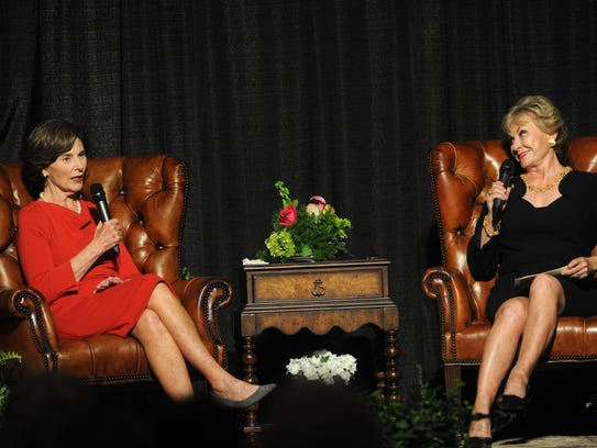 Former first lady Laura Bush, left, speaks with Dian