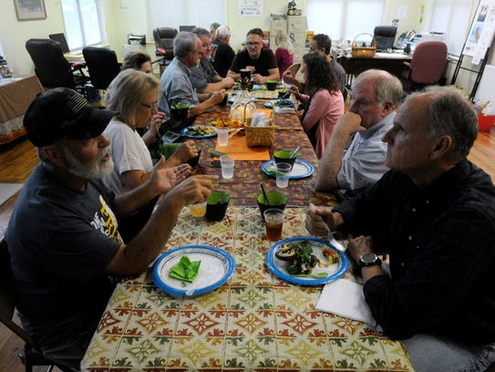 Diners share a meal together at the Souper Thursday