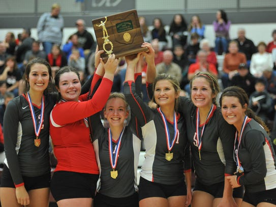 The six Buckeye Central seniors lift the district championship trophy.