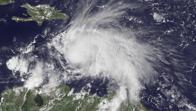 A satellite image shows Hurricane Matthew in the Caribbean Sea on September 29, 2016. It is now a Category 3 major hurricane with winds of 115 mph.