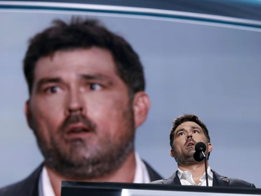 Retired U.S. Navy Seal Marcus Luttrell addresses delegates during the opening day of the Republican National Convention in Cleveland, Monday, July 18, 2016. (AP Photo/Carolyn Kaster)