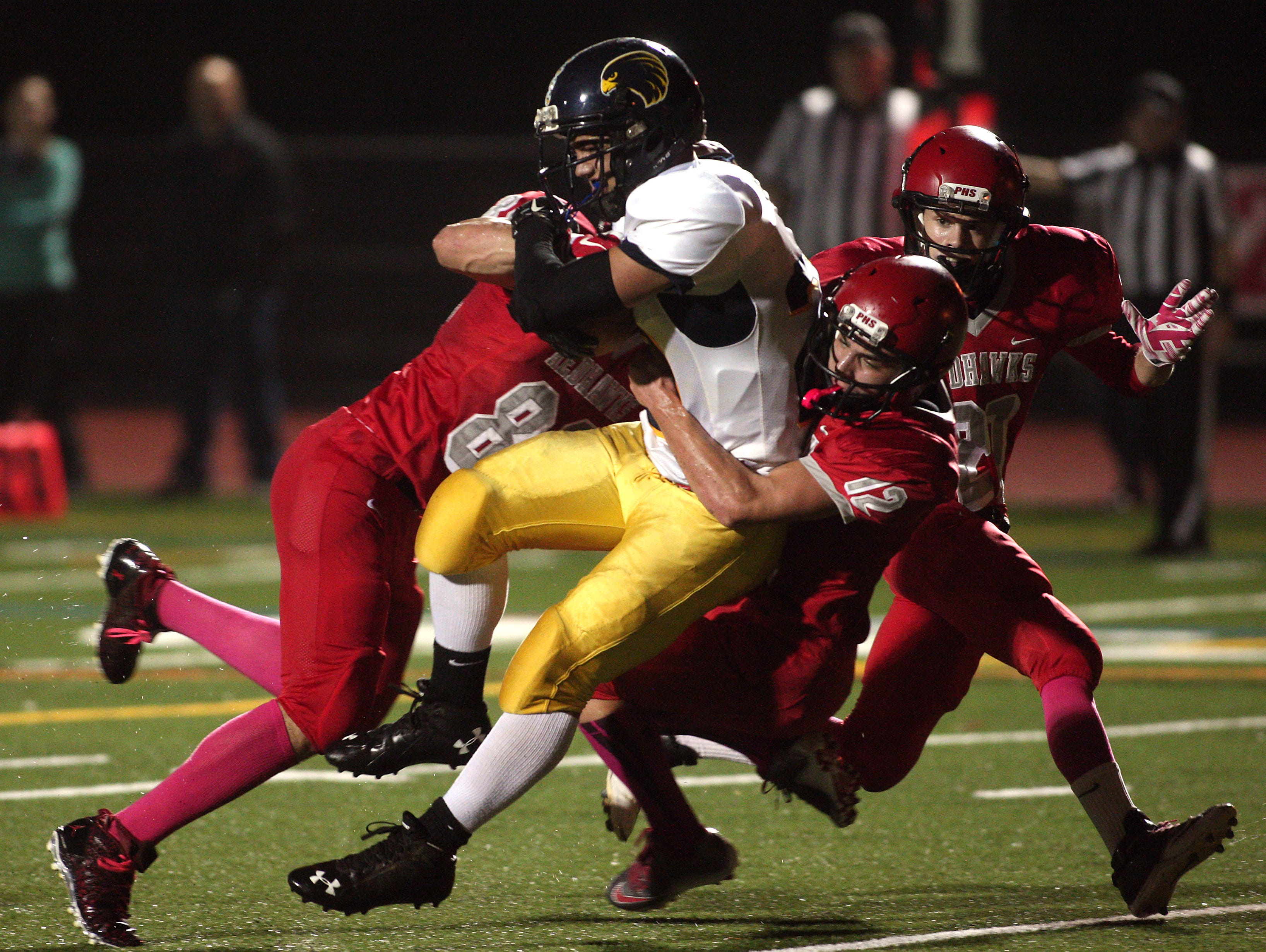 Jefferson running back Connor Brown flies into the end zone for a first half touchdown vs Parsippany in a Friday night football matchup. October 9, 2015, Parsippany, NJ.