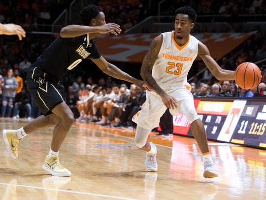 Tennessee guard Jordan Bowden (23) drives past Vanderbilt