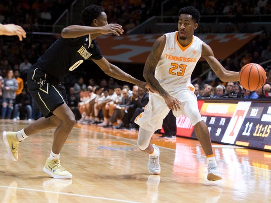 Tennessee guard Jordan Bowden (23) drives past Vanderbilt guard Saben Lee (0) during Tennessee's home basketball game against Vanderbilt at Thompson-Boling Arena on Tuesday, January 23, 2018.
