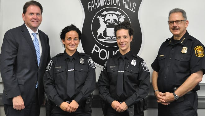 Farmington Hills City Manager Dave Boyer (from left), Officer Breeanna Streber, Officer Christine McKinney and Chief of Police Charles Nebus.