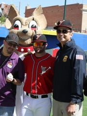 Victor Cruz, from  left, Chico the Chihuahuas' mascot, casey McElroy and Waldemar Rodriguez