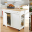 A portable kitchen island extends counter and storage space.