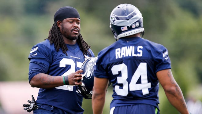 Veteran running back Eddie Lacy, left, was a major offseason signing for the Seattle Seahawks, but Thomas Rawls is currently getting most of the first-team snaps in practice.