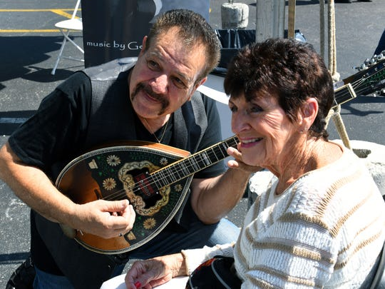 Musician Themi Kakias poses for a photo with Ruth Burton during the 38th annual Greek Fest on Kingston Pike Friday, Sep. 15, 2017.