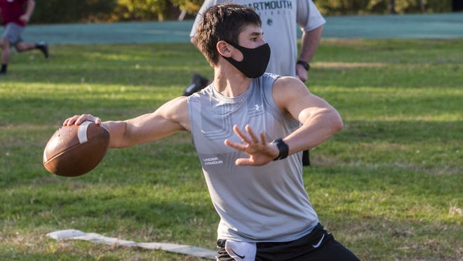 Will Kelly looks deep for his target during pre season practice for the Indians' football team.
