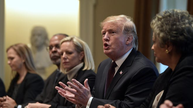 President Donald Trump, second from right, speaks in the Cabinet Room of the White House in Washington, Wednesday, Jan. 23, 2019, as he hosts a roundtable with conservative leaders to discuss the security and humanitarian crisis at the southern border. Homeland Security Secretary Kirstjen Nielsen is third from left. (AP Photo/Susan Walsh)