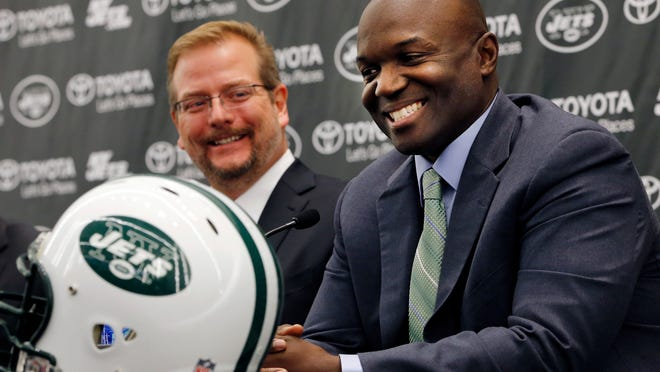 New York Jets head coach Todd Bowles, right, speaks during a press conference introducing the team's new management, Wednesday, Jan. 21, 2015, in Florham Park, N.J. Mike Maccagnan, the team's new general manager, listens at left. (AP Photo/Julio Cortez)
