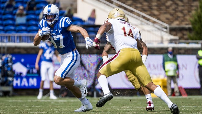 Duke's Noah Gray of Leominster looks for yardage in a game against Boston College this past season.