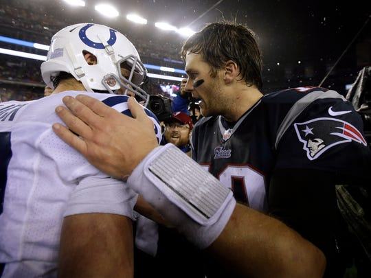 New England Patriots quarterback Tom Brady, right, speaks to Indianapolis Colts quarterback Andrew Luck after the AFC Championship game Sunday, Jan. 18, 2015, in Foxborough, Mass. The Patriots defeated the Colts 45-7 to advance to the Super Bowl against the Seattle Seahawks.