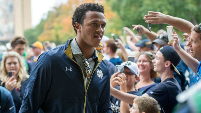 Oct 15, 2016; South Bend, IN, USA; Notre Dame Fighting Irish quarterback DeShone Kizer walks into the stadium before the game against the Stanford Cardinal at Notre Dame Stadium. Mandatory Credit: Matt Cashore-USA TODAY Sports