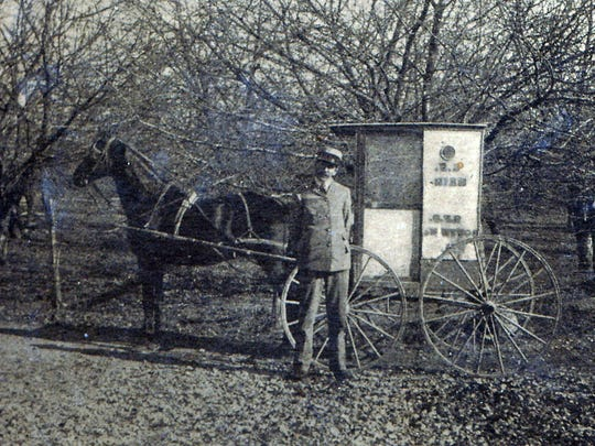 Postal employee David Zargar and his mail wagon that was used for the R.F.D. route in the early 1900s.