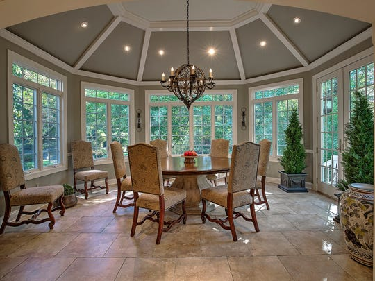 Surround yourself with nature every morning in this octagonal breakfast room off the kitchen.