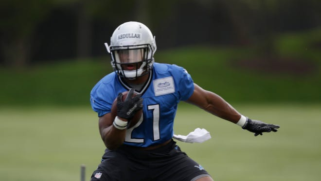 Ameer Abdullah runs the ball during Lions rookie minicamp at the Lions' Allen Park training facility May 8, 2015.