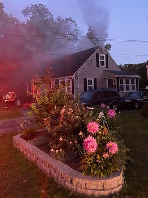 Firefighters arrived to find heavy smoke coming from the house.