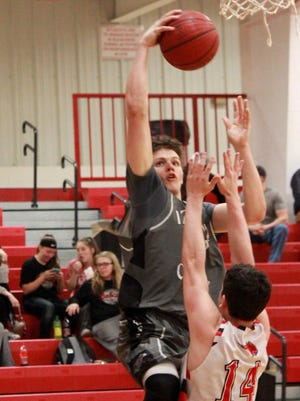 Izard County's Justus Coooper goes up against Flippin's Michael Robbins on Monday night at Flippin.