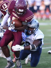 John Jay's Calvin Anthony gets a hold of Arlington's