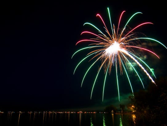 Watch fireworks lakeside at Pleasant Harbor RV Resort
