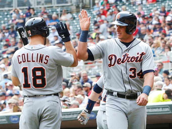 Detroit Tigers' James McCann right, high-fives with