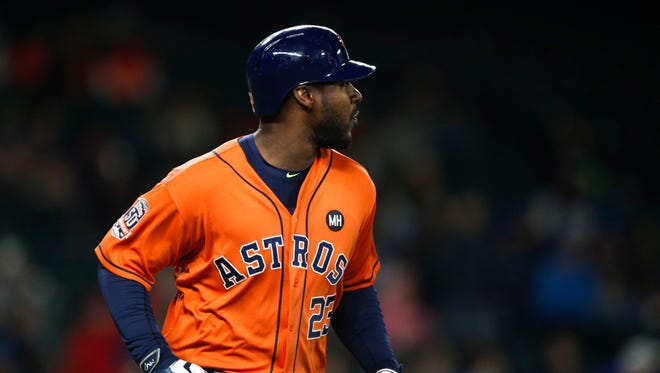 Houston Astros first baseman Chris Carter (23) watches his solo home run against the Seattle Mariners during the seventh inning at Safeco Field.