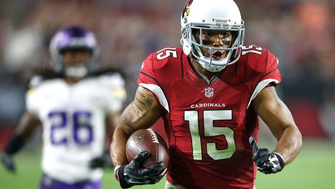 Arizona Cardinals wide receiver Michael Floyd runs for a touchdown during an NFL game on December 10, 2015, in Glendale.
