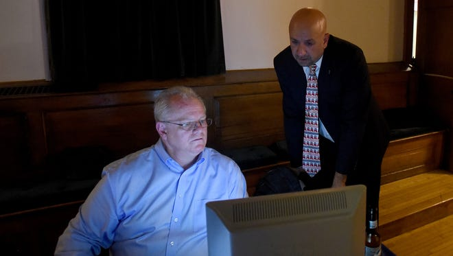 Newark Mayor Jeff Hall and Jeff Rath watch results come in during the Licking County Republican Party watch party at the Elks Lodge on Tuesday, Nov. 7, 2017. Rath defeated Democratic challenger Jen Kanagy for the Newark City Council 3rd Ward seat.