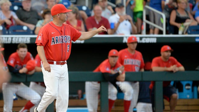 Jun 22, 2016: Arizona Wildcats head coach Jay Johnson signals for a new pitcher in the eighth inning against the UC Santa Barbara Gauchos in the 2016 College World Series at TD Ameritrade Park. Arizona defeated UC Santa Barbara 3-0.