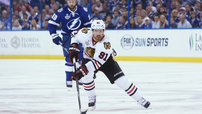 Chicago Blackhawks center Brad Richards (91) skates with the puck against the Tampa Bay Lightning in the first period in game one of the 2015 Stanley Cup Final at Amalie Arena.