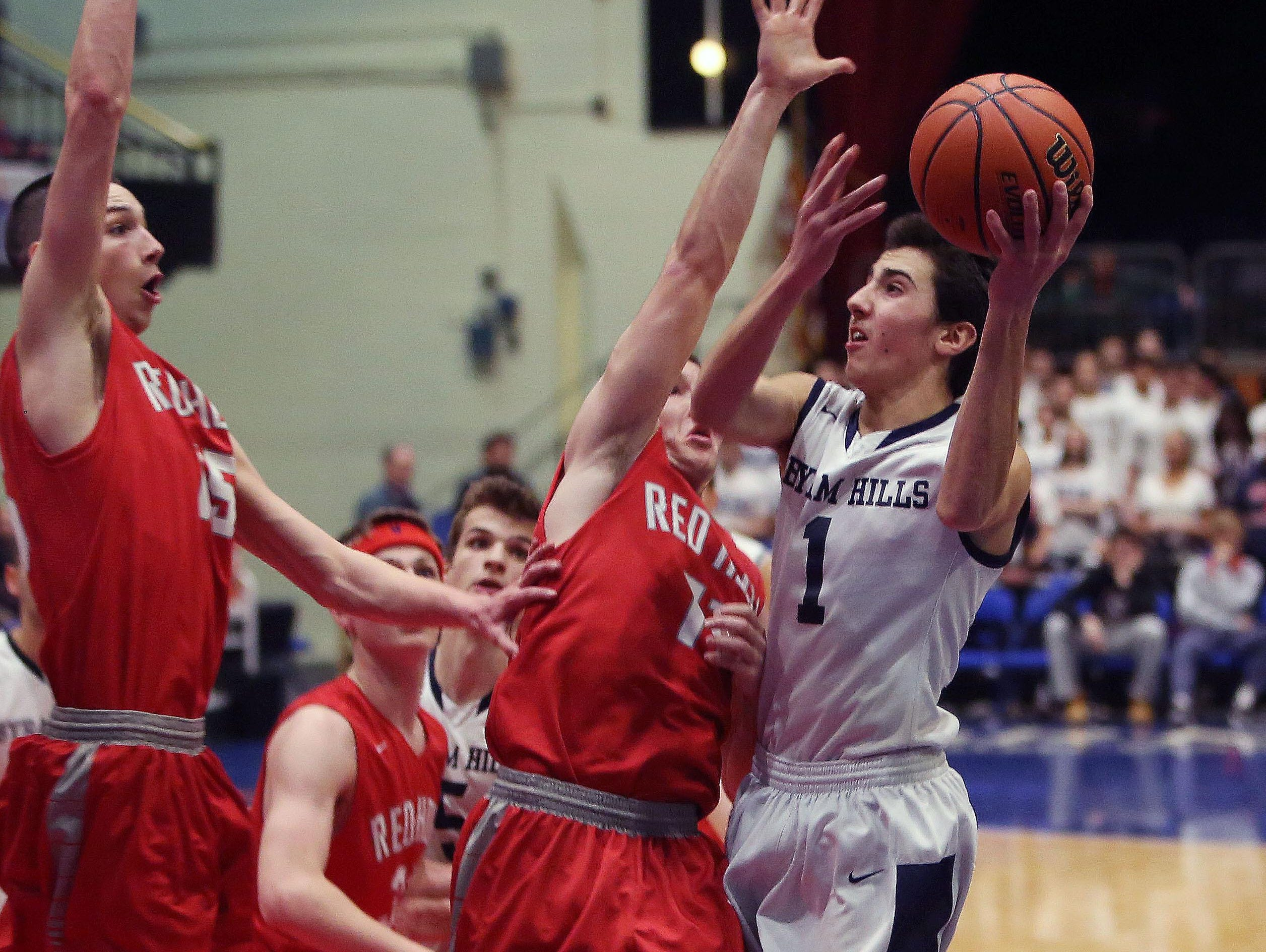 Byram Hills' Matt Milone (1) drives to the basket against Red Hook during the boys Class A basketball playoff game at the Westchester County Center in White Plains March. 1, 2016.