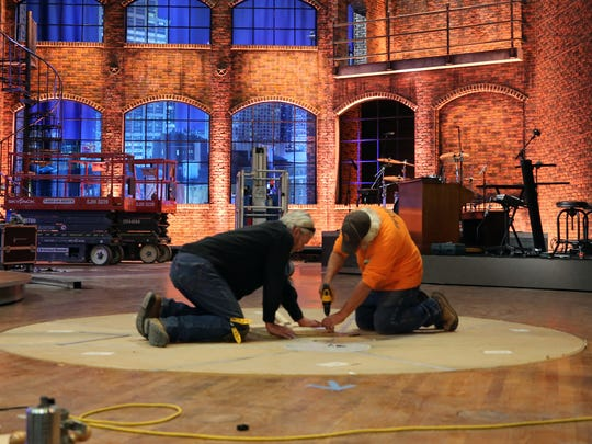 Workers build the set for Mike Huckabee's upcoming