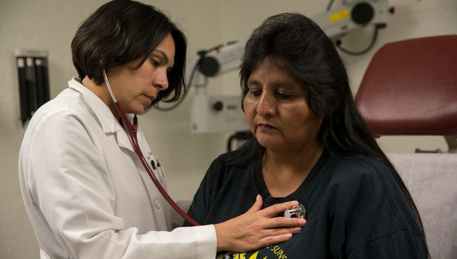 Dr. Dena Wilson examines patient Doris Miguel at Indian Health Service in Phoenix in May, 2017.