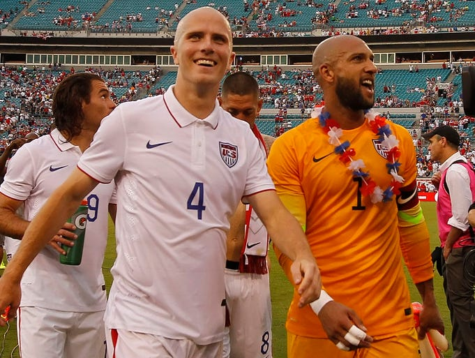 Midfielder Michael Bradley and goalkeeper Tim Howard smile after they beat Nigeria at EverBank Field.