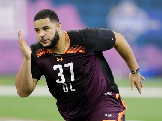FILE - In this March 1, 2019, file photo, Texas A&M offensive lineman Erik McCoy runs a drill during the NFL football scouting combine, in Indianapolis. McCoy is a possible pick in the 2019 NFL Draft. (AP Photo/Darron Cummings, File)